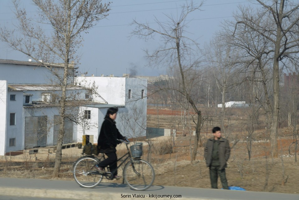 North Korea - Woman on a bicycle